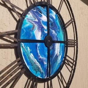 Custom clock with pour art in the center.